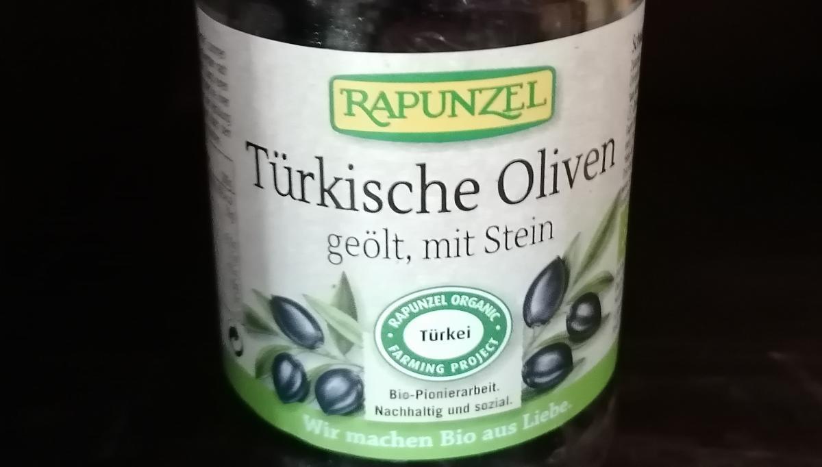 Türkische, schwarze Oliven, geölt mit Stein